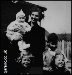 Leggetts family in front British military ambulance 1954