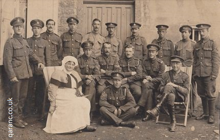 RAMC personnel on the Western Front with QAIMNS Reserve Staff Nurse holding bird