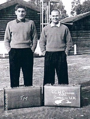 Terry Manning and Sid Coombs ready for home in 1959 outside barracks with old army suitcases