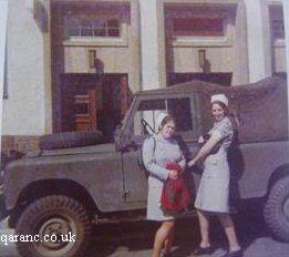 Two QA Nurse By Land Rover