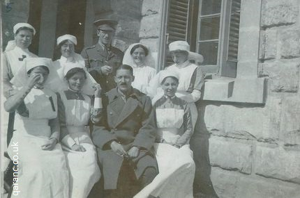 group photo nurses doctors great war uniforms aprons veils greatcoat